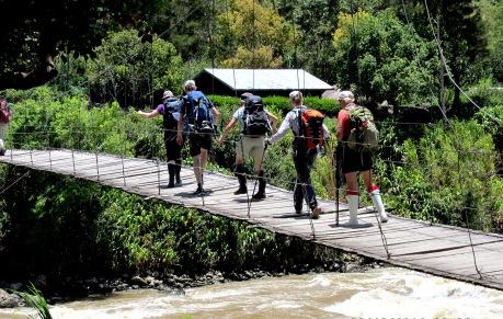 trekking crossing the baliem river